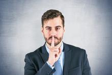 Businessman Making Hush Sign