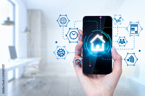 Woman hand with phone smart home interface in room Fototapeta