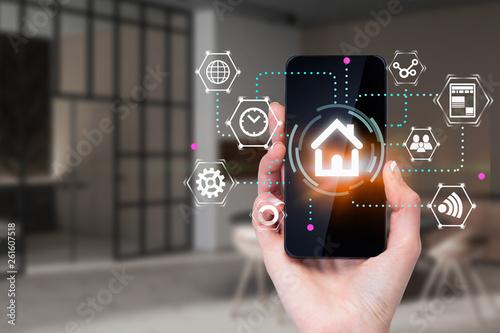 Obraz na płótnie Woman hand with phone, smart home concept