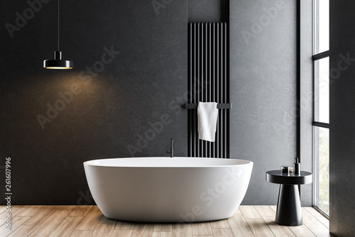 Fotografia  Dark gray bathroom with white tub