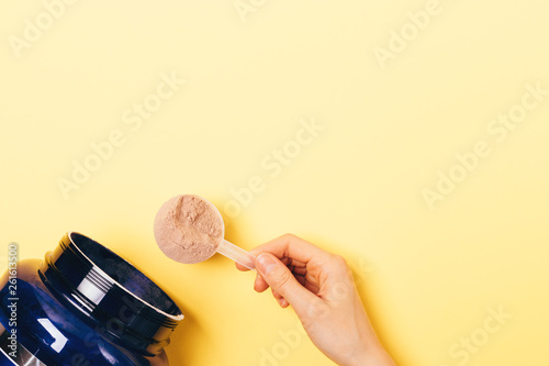 Fototapeta View from above female hand takes spoonful
