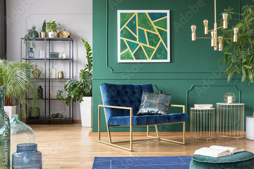 Photo  Stylish living room interior idea with green, blue and gold colors