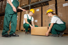 Two Young Warehouse Workers In...