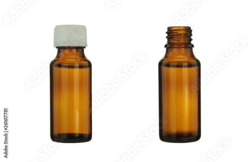 Photo  Brown dropper bottle on a white background.