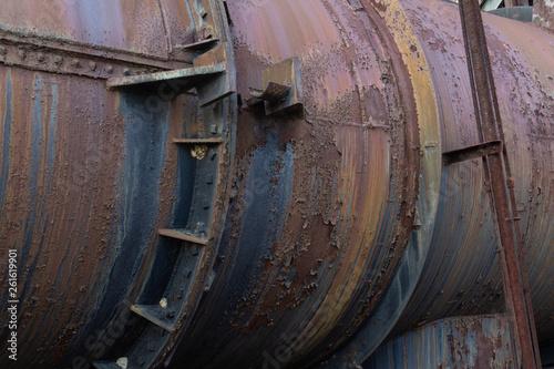 Fotografie, Obraz  Metal industrial pipe with gaskets, rivet construction, rust patina, horizontal