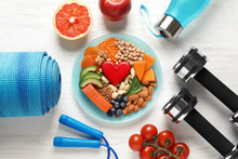 Plate With Heart-healthy Products And Sports Equipment On Wooden Background, Flat Lay