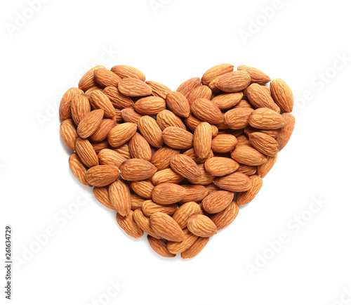 Heart made of almonds on white background, top view. Healthy diet Wallpaper Mural