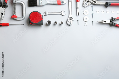 Obraz Flat lay composition with construction tools on light background, space for text - fototapety do salonu