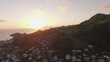 Aerial View Flying over small village at sunset 02