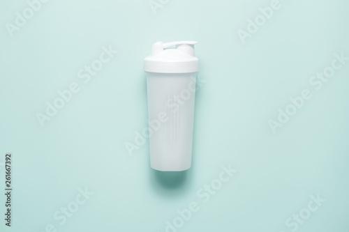 White plastic sports shaker on pastel turquoise background Wallpaper Mural