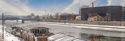 Fototapeta KRAKOW, POLAND - JANUARY 23, 2017: Barges on Wisla river on cold winter day obraz