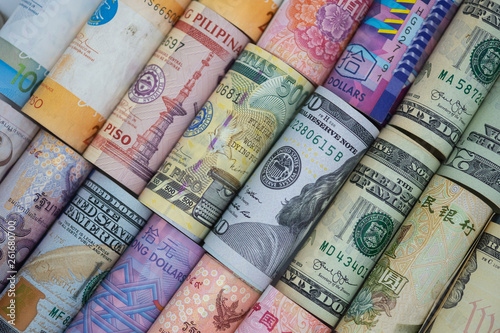 Fototapeta Closeup rolled of variety banknote around the world. Exchange rate and Forex investment concept.-Image. obraz