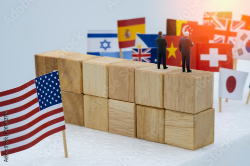 Photo USA China and multi countries flags with wooden fence