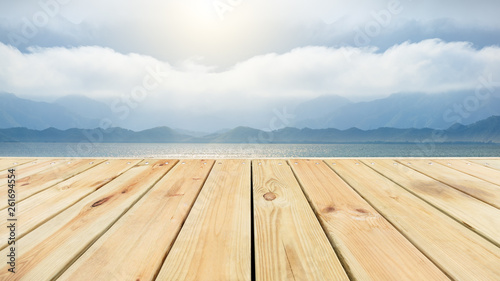 Valokuva Wooden floor platform and lake with sky background