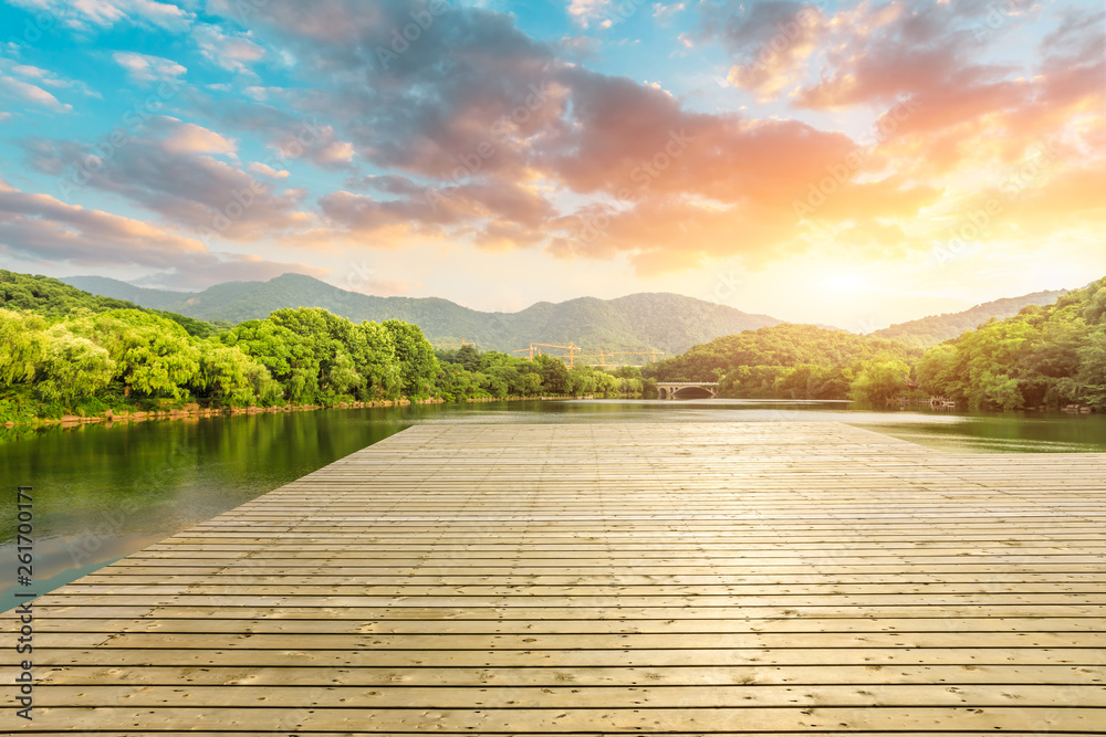 Fototapety, obrazy: Wooden floor platform and lake with green mountains background in Hangzhou