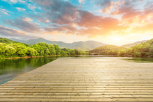 Wooden Floor Platform And Lake With Green Mountains Background In Hangzhou