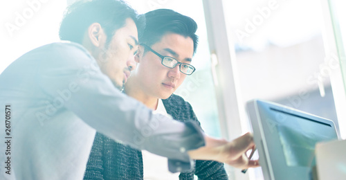 Obraz na plátně  two asian businessmen working together in office