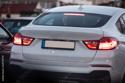 beautiful white luxury car stuck in traffic - 261701729