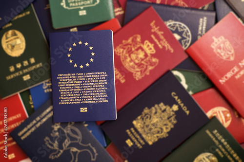 Fotografía Blue biometric passport of the European Union on a blurred background of mixed p