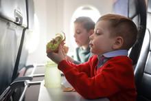 Children Eat On The Plane