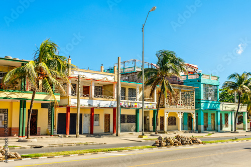 Old Spanish colonial houses with palms along the street in the c Canvas Print