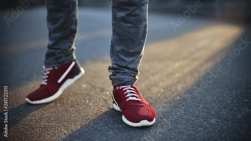 Close up of man, red sneakers on street Fototapeta
