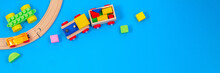 Baby Kid Toy Background. Wooden Toy Train With Colorful Blocks On Blue Background
