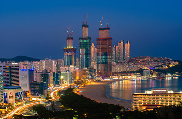 Busan beach view from roof top of hotel in Busan city in night time with blue sky and full moon, South Korea, this picture can use for tavel, Busa, South Korea and  city concept