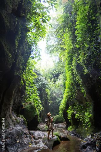 Woman near waterfal on Bali, Indonesia Fototapet