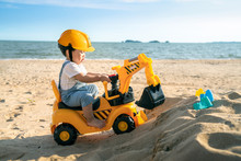 Asian Boy Play A Excavator Toy...