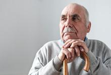 Elderly Grey Haired Retired Man With Walking Stick