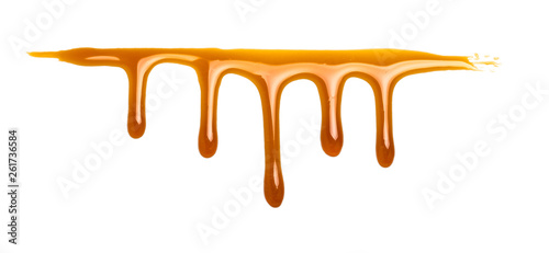Stampa su Tela  sweet caramel sauce isolated on white background Top view or flat lay