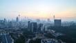 Dramatic sunrise over Kuala Lumpur city skyline.