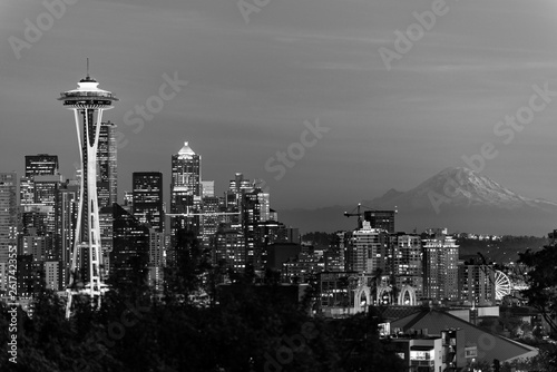Black and white image of the skyline of the city of Seattle and the profile of Mount Rainier in the background.