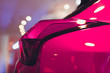 canvas print picture - Detail on the rear light of a pink car.