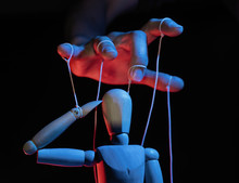 Concept Of Control. Marionette...