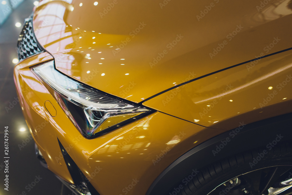 Fototapety, obrazy: Car detailing series: Clean headlights of yellow sports car.