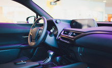 Dark Luxury Car Interior - Steering Wheel, Shift Lever And Dashboard.