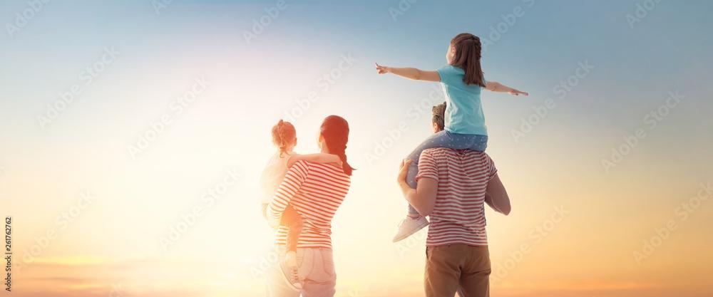 Fototapety, obrazy: happy family at sunset.