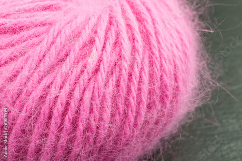 Photo ball of pink angora wool against black background