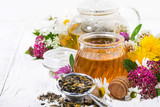 fresh flower honey, tea and ingredients on white wooden background - 261802787