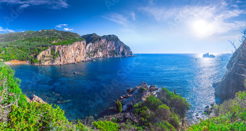 Staande foto Asia land Beautiful summer panoramic seascape. View of Paleokastritsa famous beach in close bay with crystal clear azure water on Corfu island, Ionian archipelago, Greece.