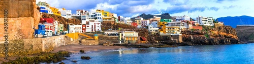 Poster Canary Islands Travel in Grand Canary - scenic coastal town Puerto de Sardina in north. Canary islands