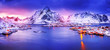 canvas print picture - Amazing panoramic view on lovely arctic village Reine on Lofoten islands in Norway, Scandinavia, Europea. Beautiful polar peaks and dramatic sunset sky in background.