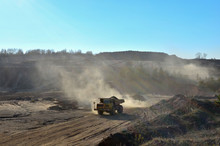 Big Yellow Mining Truck Transporting Sand In An Open-pit Mining Quarry - Image