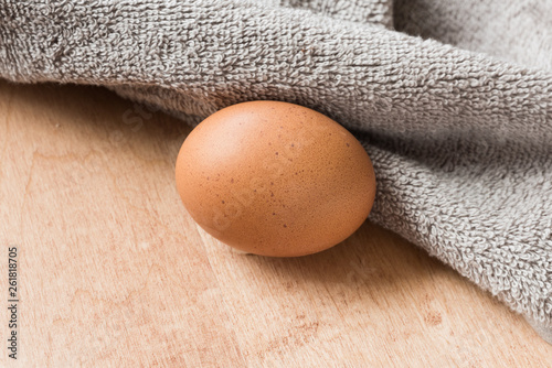 brown eggs on a wooden kitchen table.