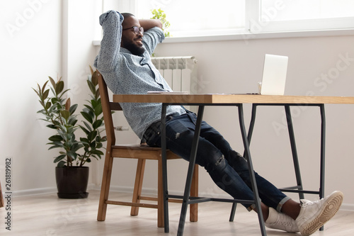 Fotografía  Relaxed african american businessman chilling in office room finished work