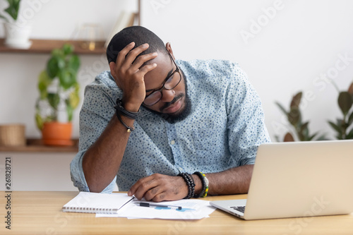 Tired depressed bored african businessman frustrated by business failure Canvas-taulu