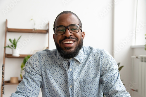 Obraz Happy african businessman looking at webcam making conference video call - fototapety do salonu