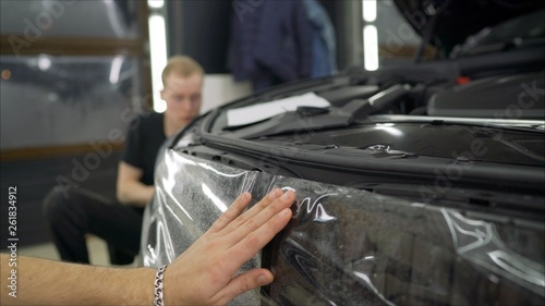 Pasting A Protective Film Of The Automotive Bumper Film For Car